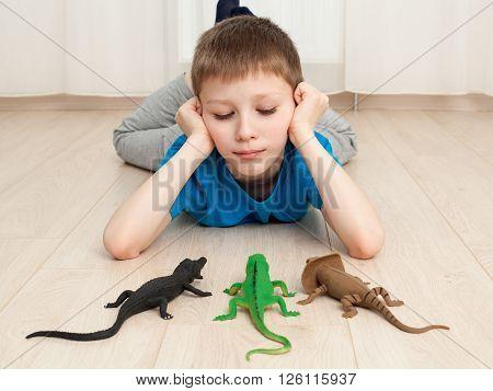 Boy Playing With  Toys - Lizard, Dinosaur, Crocodile