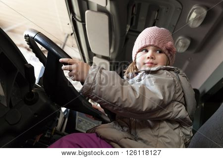 Cute Baby Girl Driving Big Cargo Truck