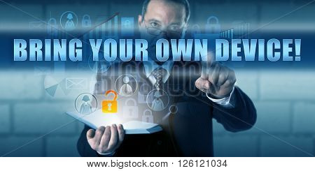 Corporate director is pushing BRING YOUR OWN DEVICE! on a touch screen. Business metaphor and information technology concept for employees using their own devices to store sensitive company data.