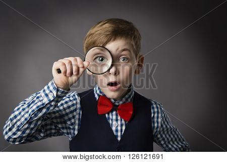 Child See Through Magnifying Glass, Gray Background