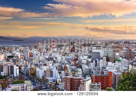 Kagoshima, Japan cityscape at dusk.