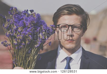 Businessman Purple Flower Holding Concept