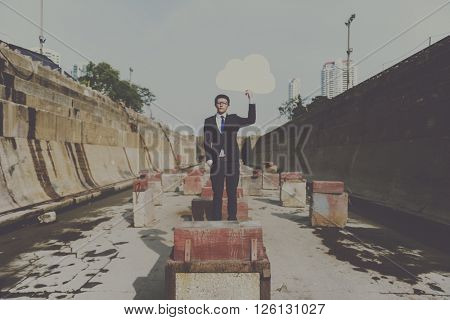Businessman Holding Cloud Network Symbol Concept