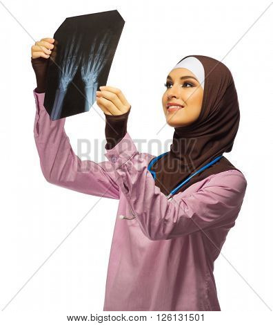 Muslim woman doctor with X-ray isolated
