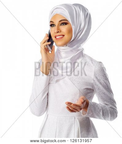 Muslim woman in white dress with phone isolated
