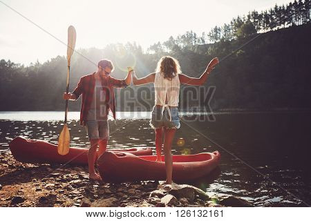 Couple Going For A Canoe Ride In The Lake.