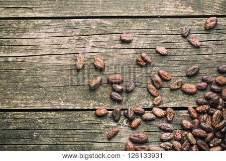 cocoa beans on old wooden table