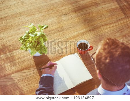 Man and Notebook with Copy Space