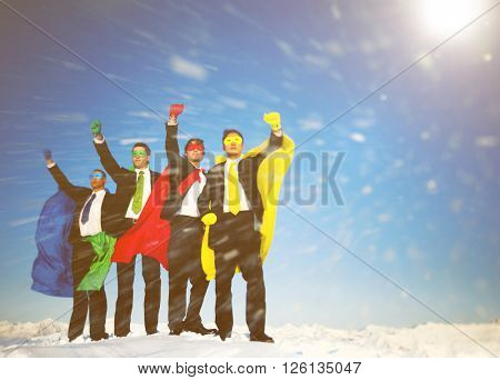 Business superheros in blizzard with arms raised.