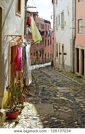 LISBON, PORTUGAL - MARCH 7 2016:A narrow street in Alfama district in Lisbon, Portugal