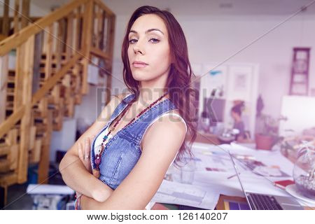 Young woman standing in creative office