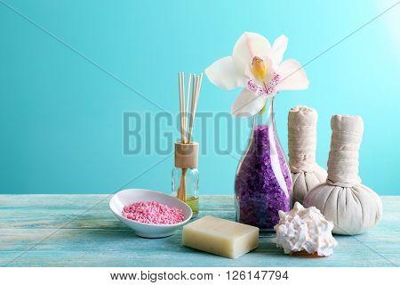 Spa treatment with sea salt on blue background