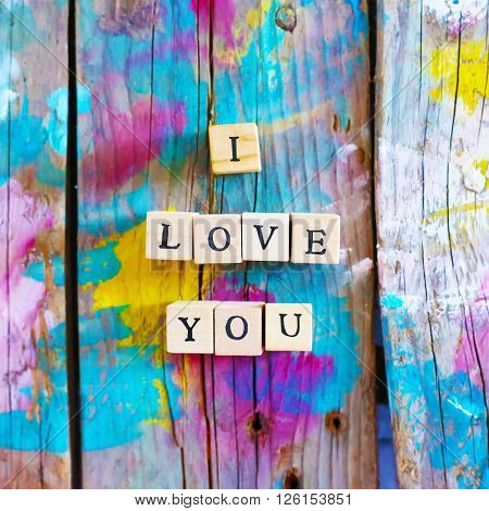 Photo of wooden block with word LOVE