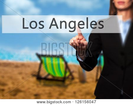 Los Angeles - Businesswoman Hand Pressing Button On Touch Screen Interface.