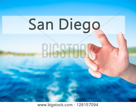 San Diego - Hand Pressing A Button On Blurred Background Concept On Visual Screen.