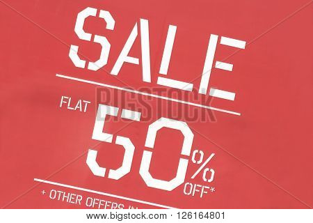 Discount sale sign in front of a retail clothes store