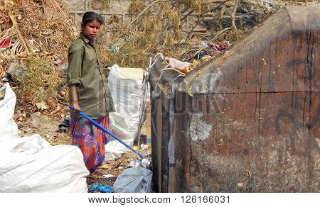 HYDERABAD,INDIA-MARCH 6::Indian rag pickers search for recyclable material in the garbage collection center on March 6,2016 in Hyderabad,India.