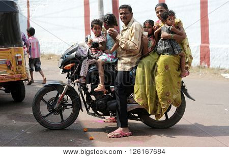 HYDERABAD,INDIA-MARCH 24:Motor cyclist drive unsafe with total six members of family against rule of only two people on March 24,2016 in Hyderabad.
