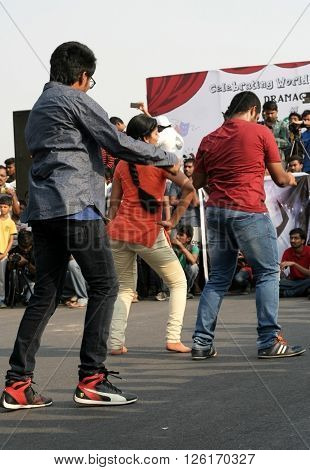 HYDERABAD,INDIA-MARCH 27:Indian young people dancing on open road event on Sunday morning, celebrating World theatre day on March 27,2016 in Hyderabad,India.