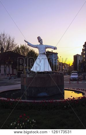 Kutahya, Turkey - April 10, 2016:  Semazen statue on sunset in Kutahya city, Turkey