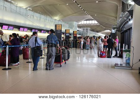 NEWARK USA - JULY 7 2013: People wait at Newark Liberty Airport in Newark. With 33.7 millions of total passenger traffic it is the 14th busiest airport in the US (2011).