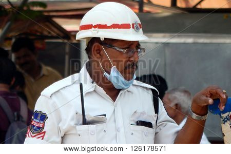 HYDERABAD,INDIA-APRIL 14:Indian Traffic police man operate the control panel to switch the road traffic signals on April 14,2016 in Hyderabad,India