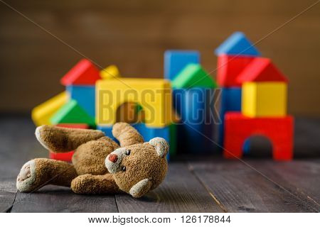 Retro Bear Toy Alone On Wooden Floor