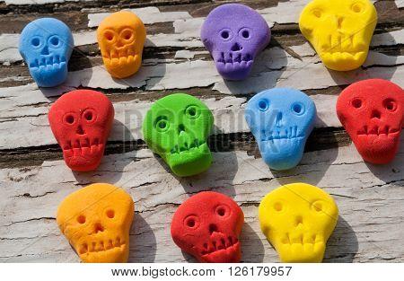 Set of colored plastic skulls for children's games