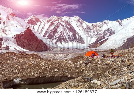 Glacier Crevasse with Melting Water Lake Red Camping Tent Female Hiker and Mountain Panorama with Clean Sky and Shining Sun poster