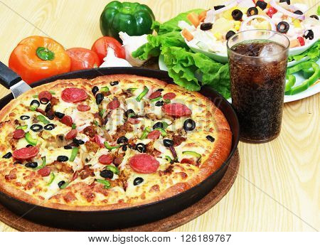 Pizza with loads of extra topping, salad and soft drink