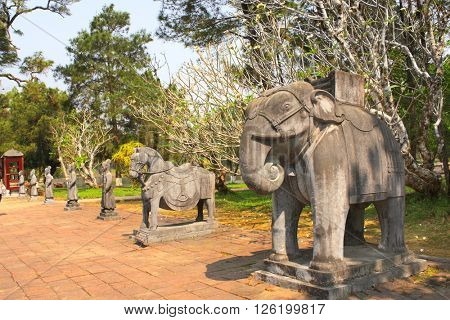 Stone statues of horse, elephant and people in Imperial Minh Mang Tomb of the Nguygen dynasty in Hue, Vietnam. UNESCO world heritage site