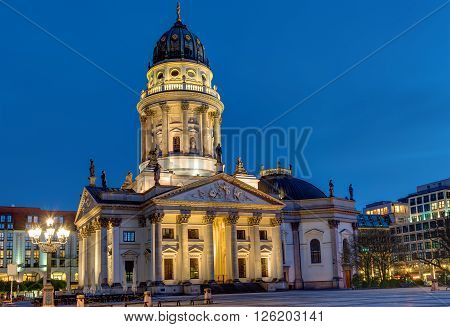 One of the two churches at the Gendarmenmarkt in Berlin at night