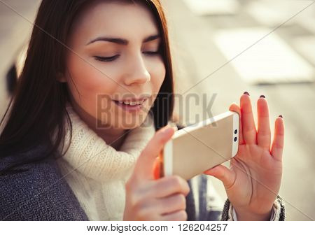 Young Girl Taking Photo On Her New Smart Phone