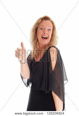 A smiling blond woman standing isolated for white background from the waist up in a black dress and showing her thump up.