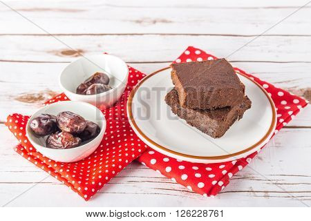 Healthy gluten free Paleo style brownies made with sweet potato dates and almond flour on a white plate