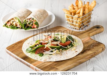 Shredded Barbecued Chicken Wraps With Carrot, Cheese, Avocado And Spinach