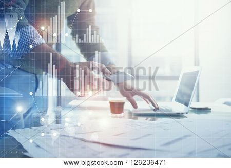 Business concept picture.Banker working new startup project modern office.Holding contemporary smartphone hands. Worldwide connection technology, stock exchanges graphics interface.