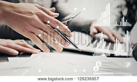 Picture of female hands with pen.Businessmans crew working investment project modern office.Using contemporary laptop. Worldwide connection technology icons, stock exchanges graphics interface.