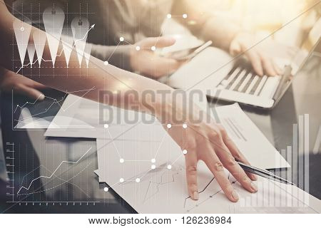 Picture of female hands with pen.Businessmans team working investment project modern office.Using contemporary laptop. Worldwide connection technology icons, stock exchanges graphics interface.
