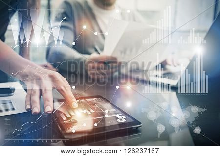 Photo female hands touching screen modern tablet. Account managers working new investment project in office. Using electronic devices. Graphics icons, worldwide stock exchanges interface.