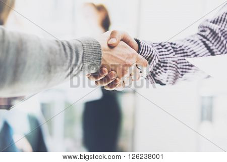 Business partnership meeting. Picture businessmans handshake. Successful businessmen handshaking after good deal. Horizontal, blurred poster
