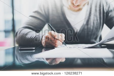 Investment manager work process.Photo man working paper documents. Private banker using pen for signs contracts. New business project startup.