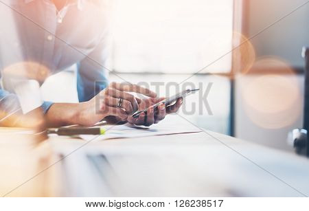 Business process photo. Account manager using mobile phone. Typing contemporary smartphone screen. Horizontal.