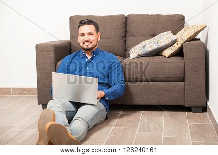 Young Man Working From Home On A Laptop