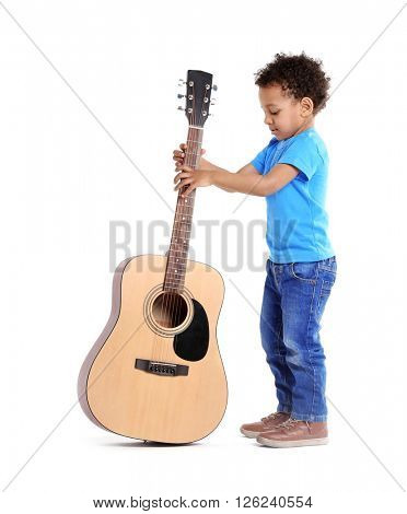 Little boy playing guitar, isolated on white