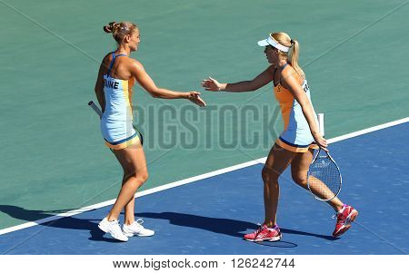 KYIV UKRAINE - APRIL 17 2016: Kateryna Bondarenko and Olga Savchuk of Ukraine react during BNP Paribas FedCup match against Maria Irigoyen of Argentina at Campa Bucha Tennis Club in Kyiv Ukraine