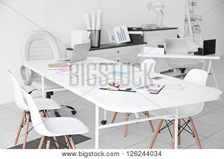Table of architect with drafts and clipboard in the office