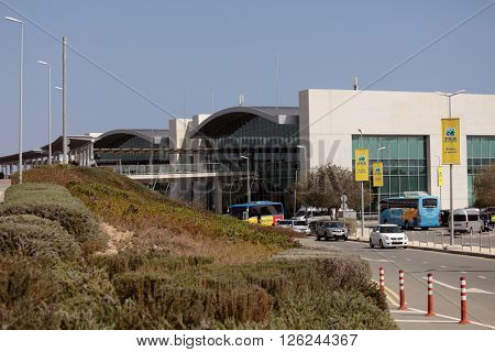 LARNACA, CYPRUS - MARCH 18, 2016: People and cars at the building of Larnaca International Airport. It is Cyprus' main international gateway and the larger of the country's two commercial airports