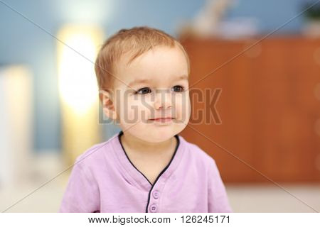 Portrait of cute baby in the room