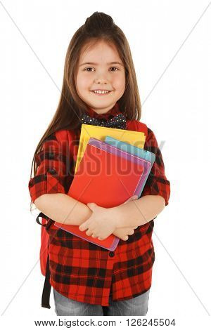 Little girl with backpack and notebooks isolated on white
